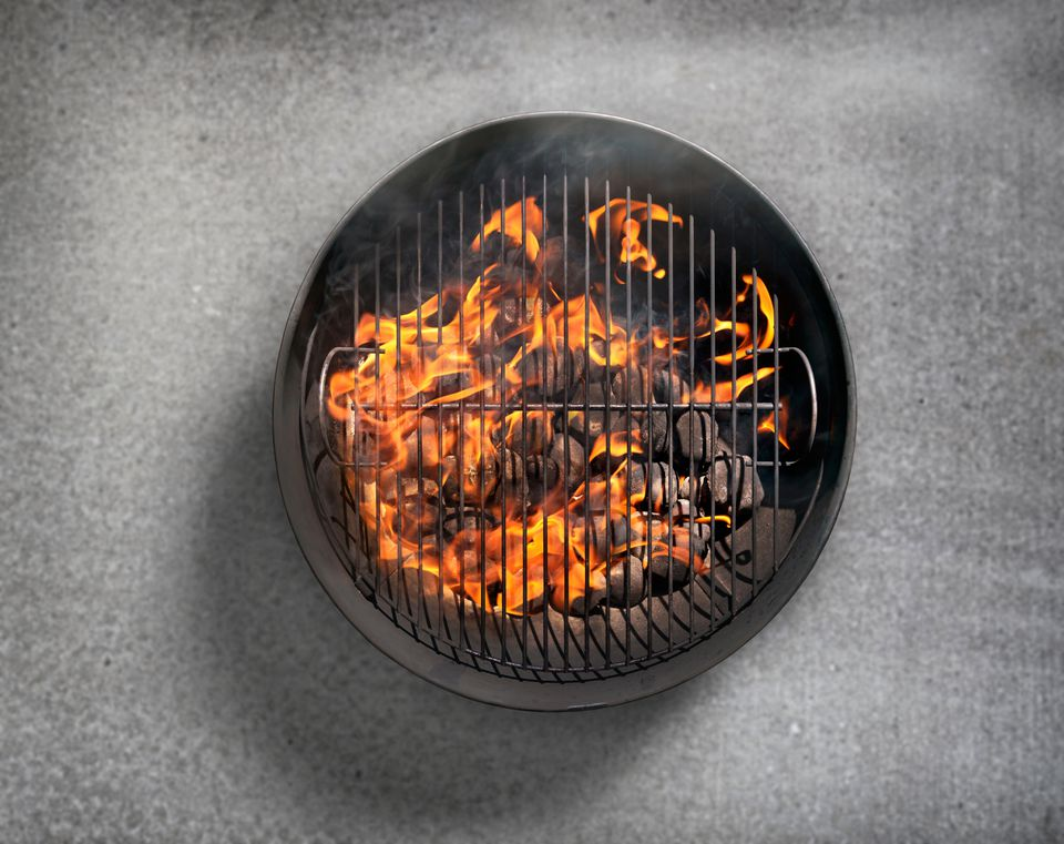 Charcoal BBQ on a Concrete Patio