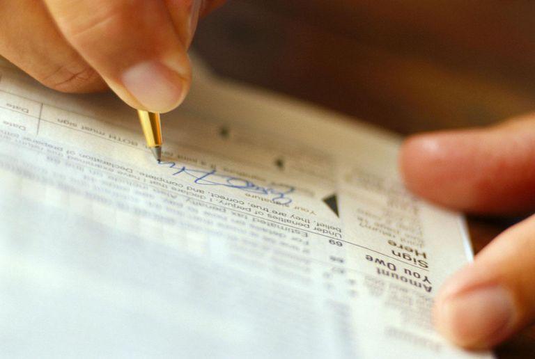 Man signing tax form, detail