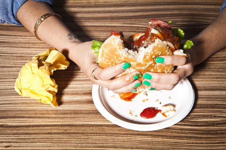 Person eating a hamburger