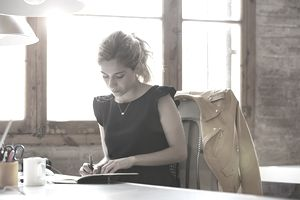 Businesswoman writing at desk