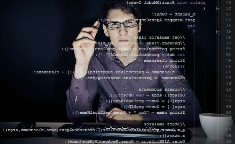 Software Developer Using Transparent Computer Screen At Office