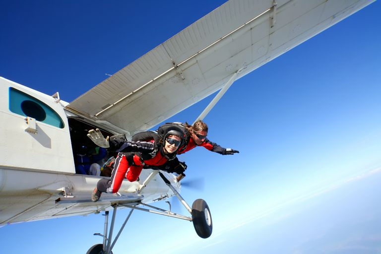 Sky divers in the atmosphere never technically free fall, but they can achieve terminal velocity. The speed depends on their form and how high up they are.