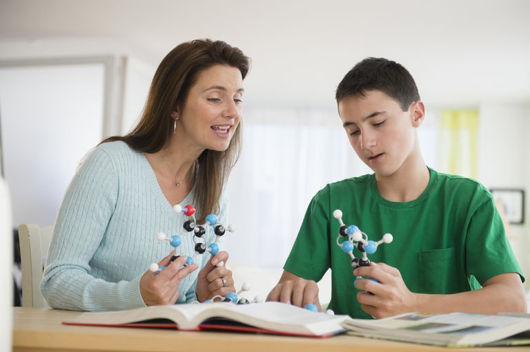 mother and son studying atom models
