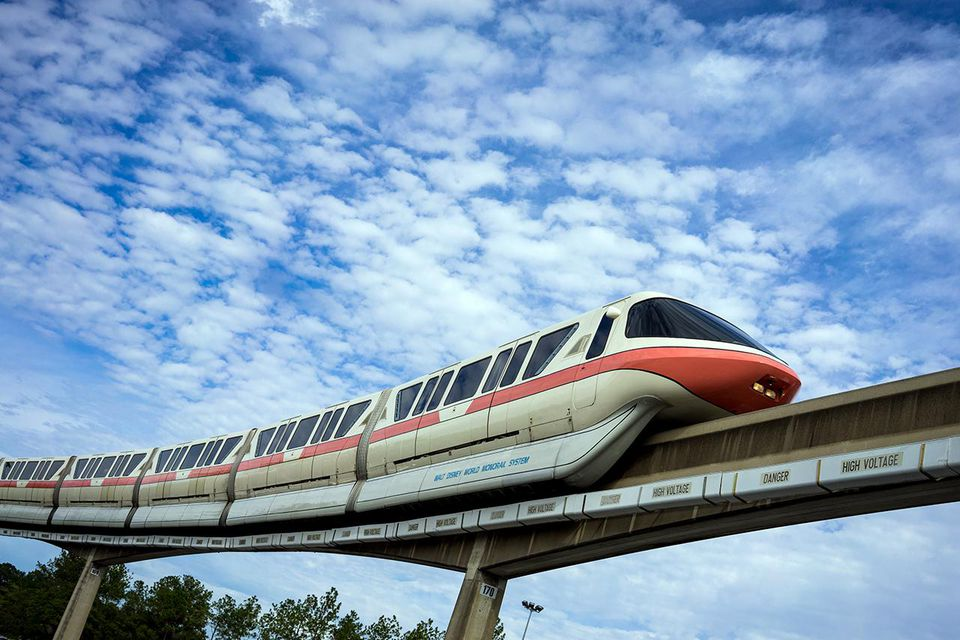 The Walt Disney World Monorail glides along the Epcot line, Epcot, Walt Disney World, Florida.