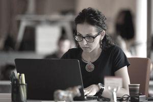 Woman Programmer altering Open Source Computer Code