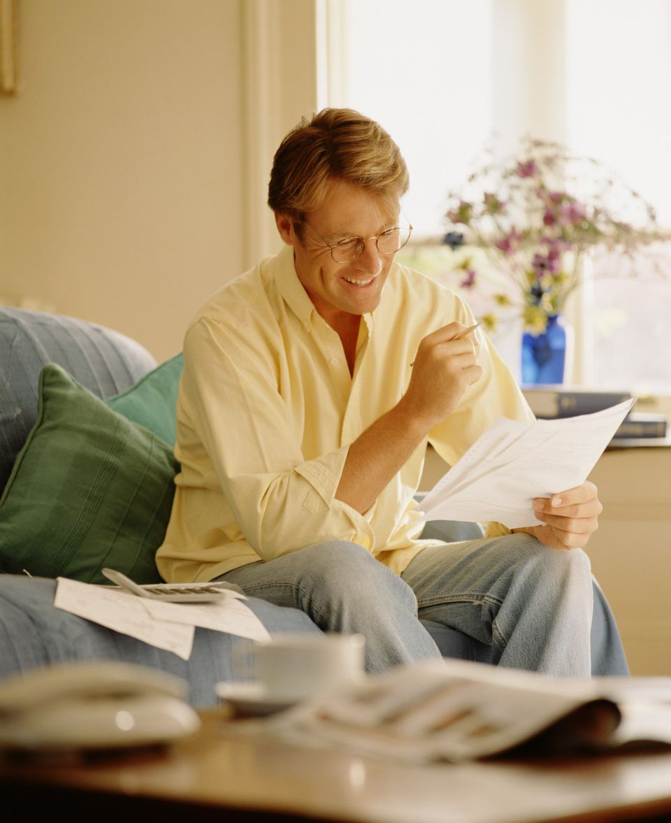 Man reading a letter