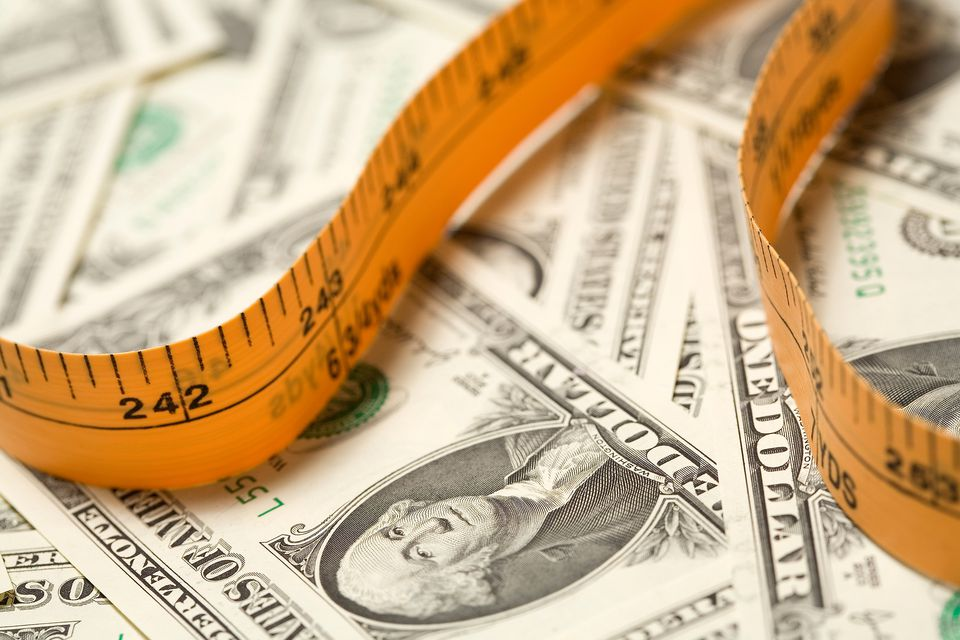 US dollar and measuring tape