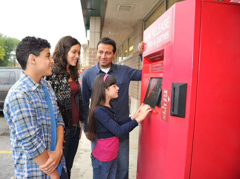 A family using a Redbox kiosk.