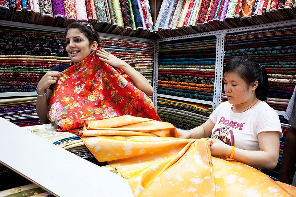 Shopping for fabric in the South Bund fabric market.