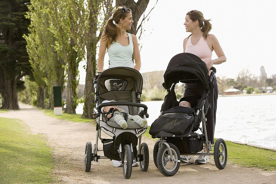 Young mothers walking with babies in strollers