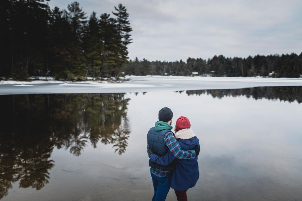 Couple by lake, Catchacoma, Ontario, Canada