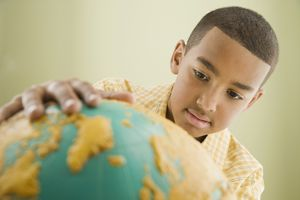 Picture of a boy looking at a globe