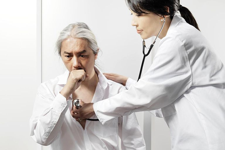 Doctor listening to patients cough