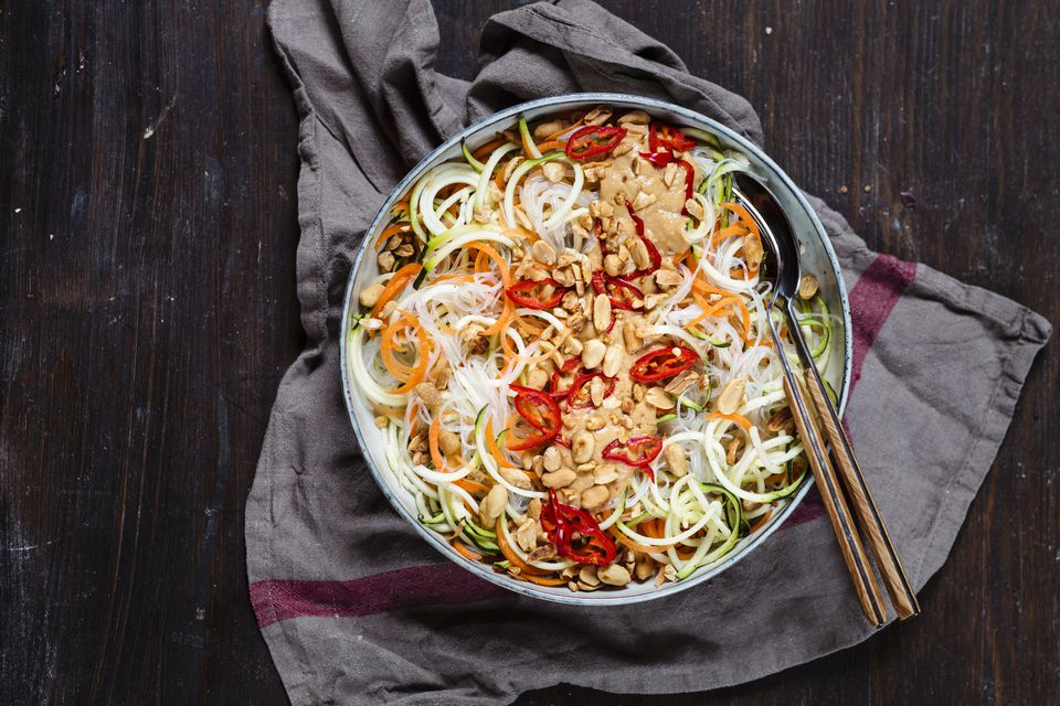 Vegan salad, spiralized zucchini and carrot with glass noodles and spicy peanut dressing