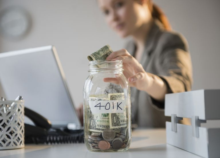 woman putting money in jar with 401K label