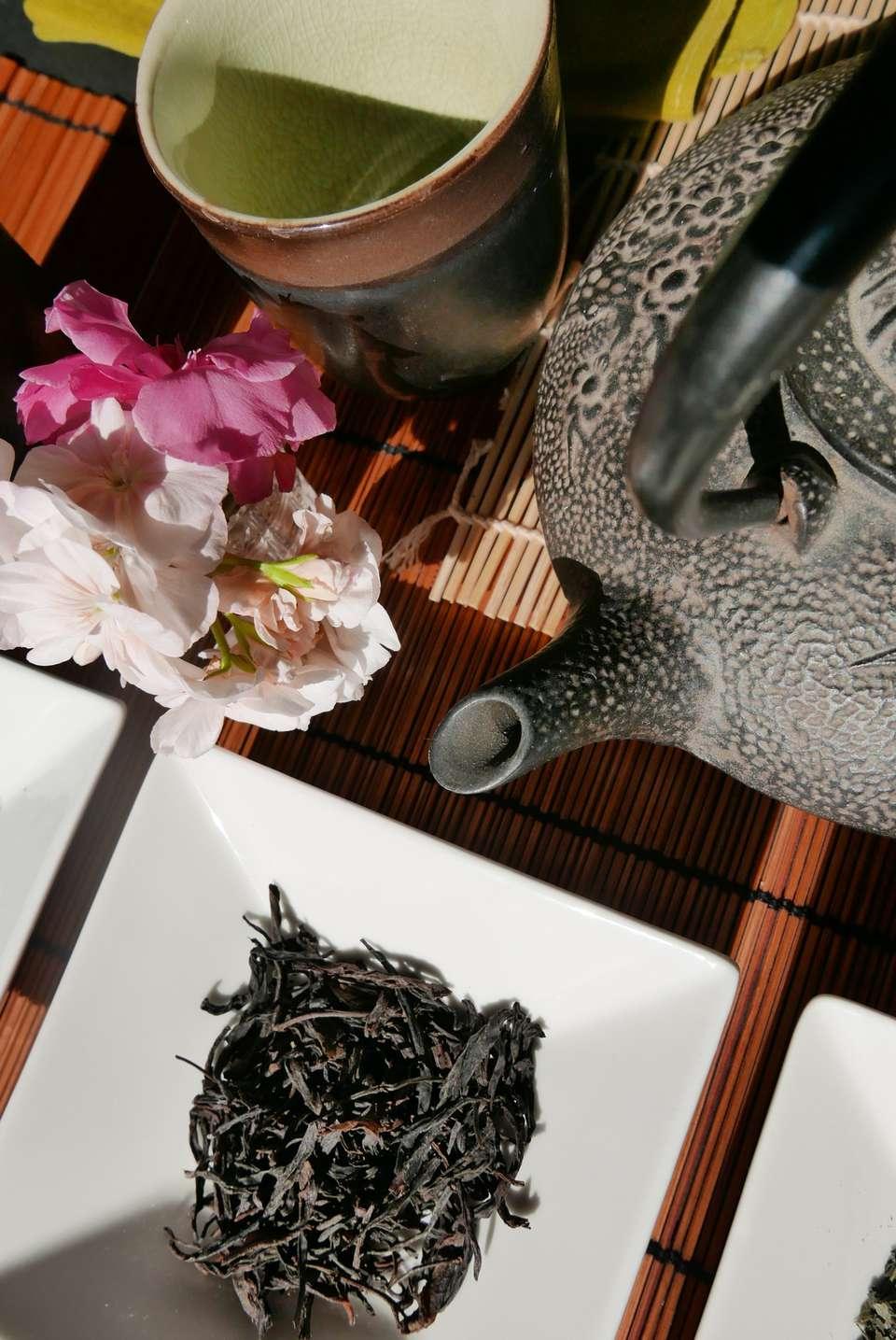 High Angle View Of Oolong Tea And Teapot