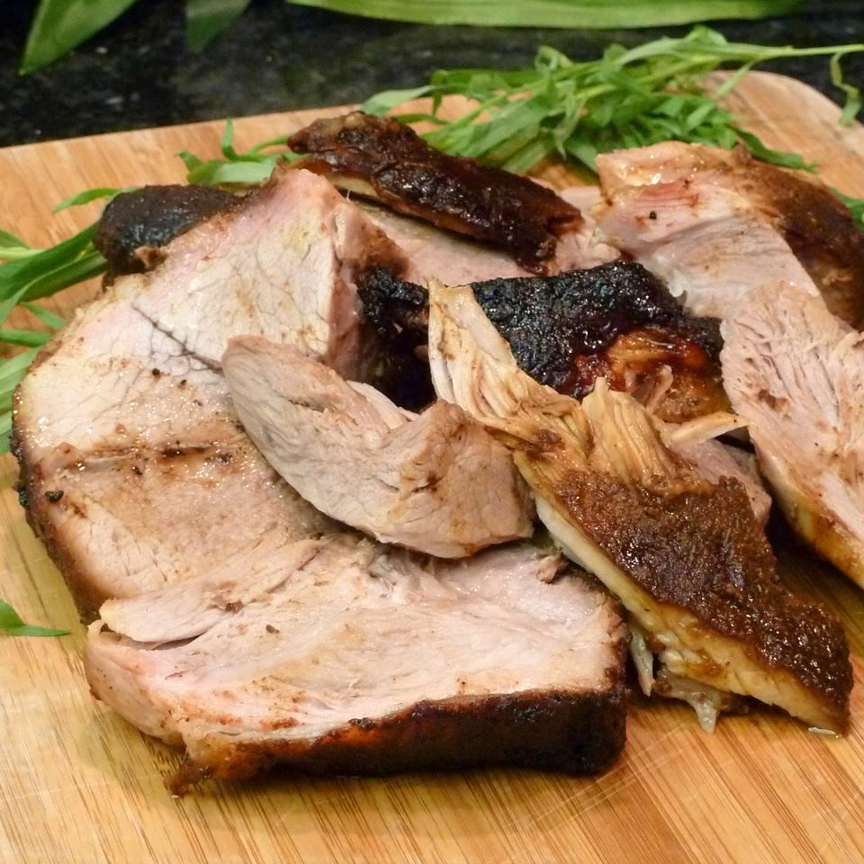 cut pork shoulder on a cutting board