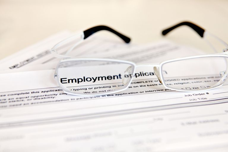 Employment application with glasses