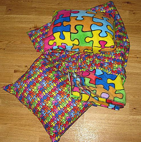 Pillow, blanket and a bag to hold it to make a perfect nap kit for Kindergarten or day care.