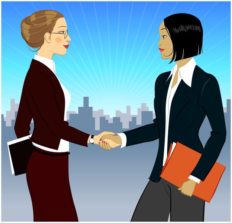 ve from Board Two businesswomen shaking hands, side view