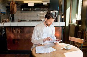 Chef using digital tablet in restaurant