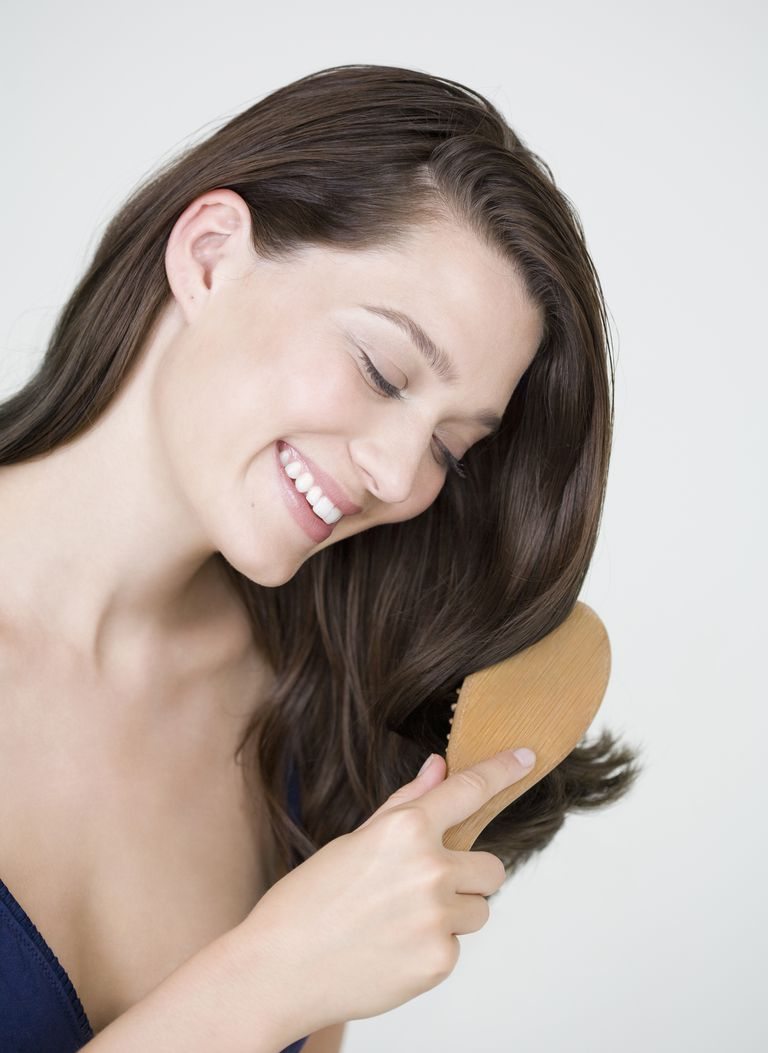 Apply dry shampoo to the roots of your hair, comb it through, and then brush or blow dry it out.