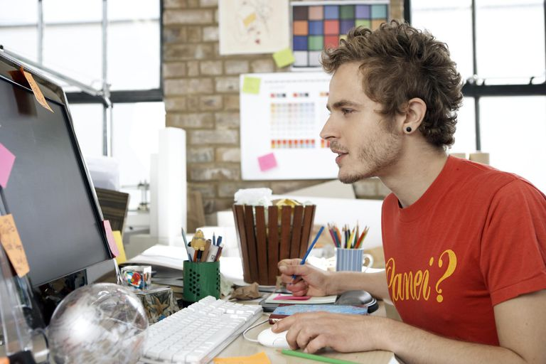 Designer focusing on his work on the computer