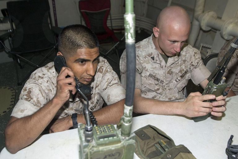 Practice tactical communication during a corporals course aboard the USS Mesa Verde (LPD 19).