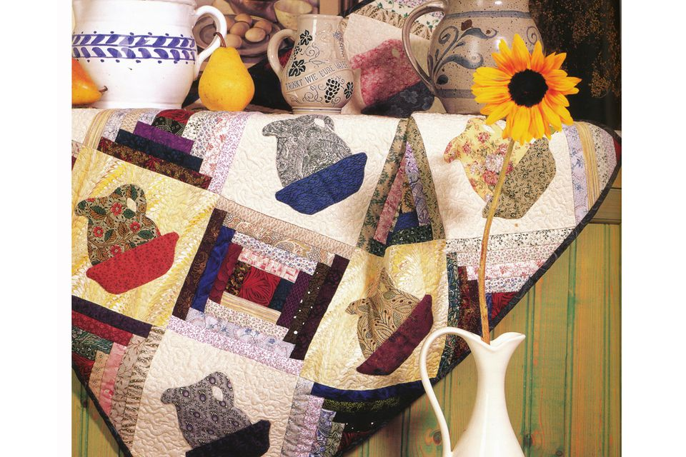 On Point Quilt with Patchwork Setting Triangles