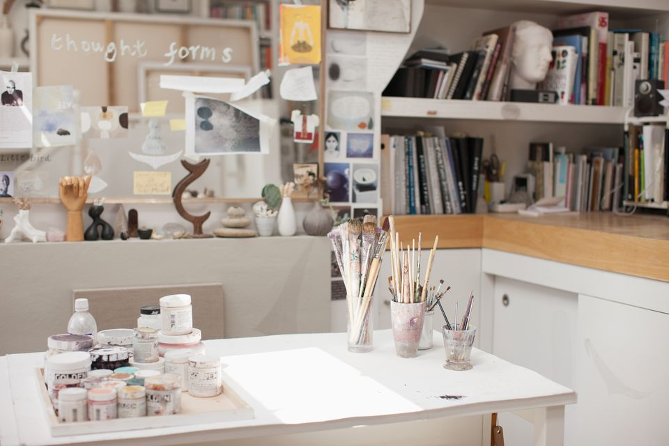 Paintbrushes in jars in an art studio