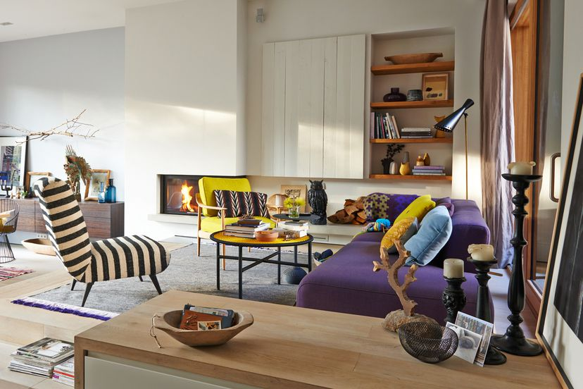 ultra violet sofa and layered rugs