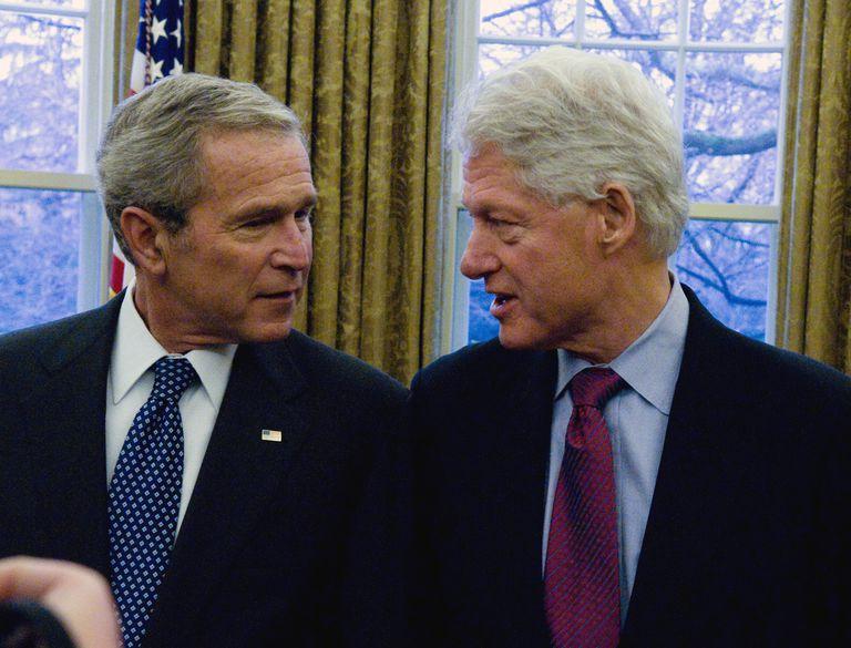 President George W. Bush (L) talks with former President Bill Clinton