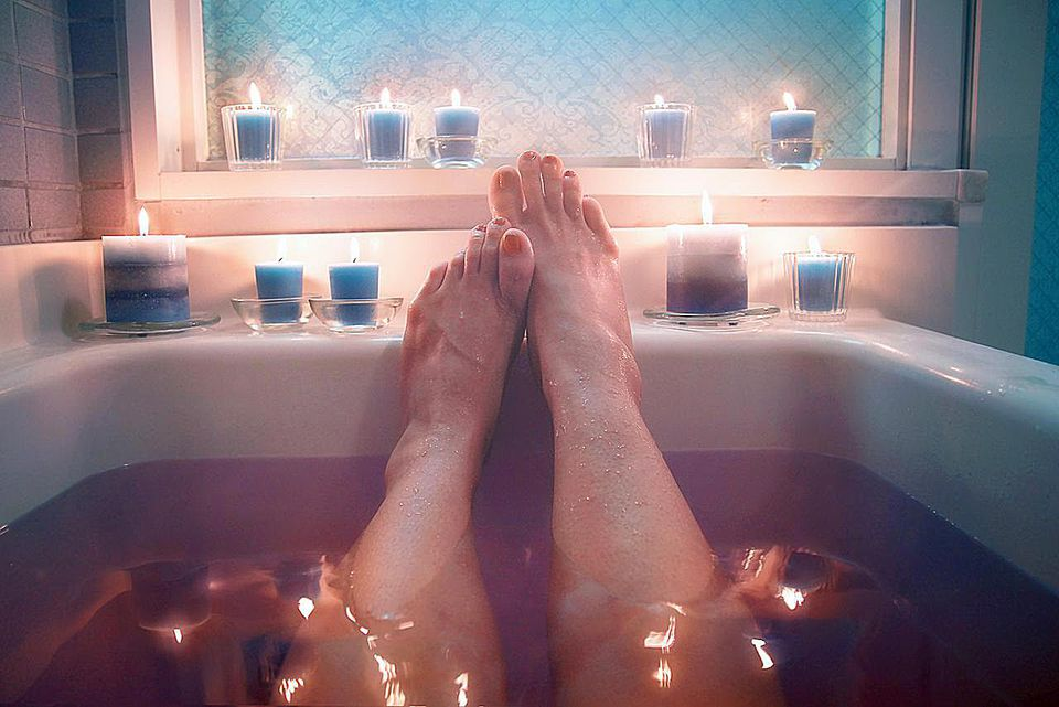 hot bath,beauty,legs,skin,health,body care,skin care,relax,relaxation,candles,light,bath,bathroom,blue,darkness,dark,quiet,steam,water,reflection,body parts,parts,woman,feet,aroma,aromatherapy