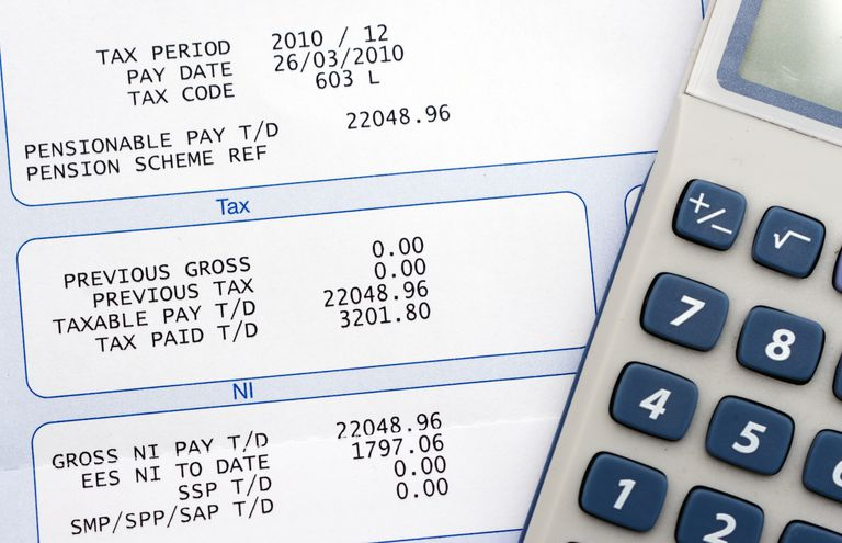 Employee paycheck shows payroll taxes and deductions.