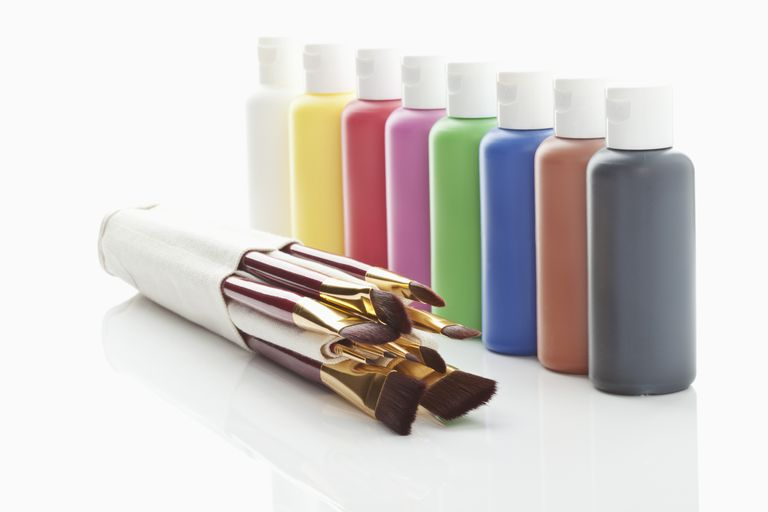 Row-of-Acrylic-color-bottles-and-paint-brushes-on-white-background.jpg