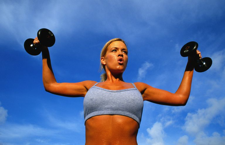 Woman Lifting Weights Outside