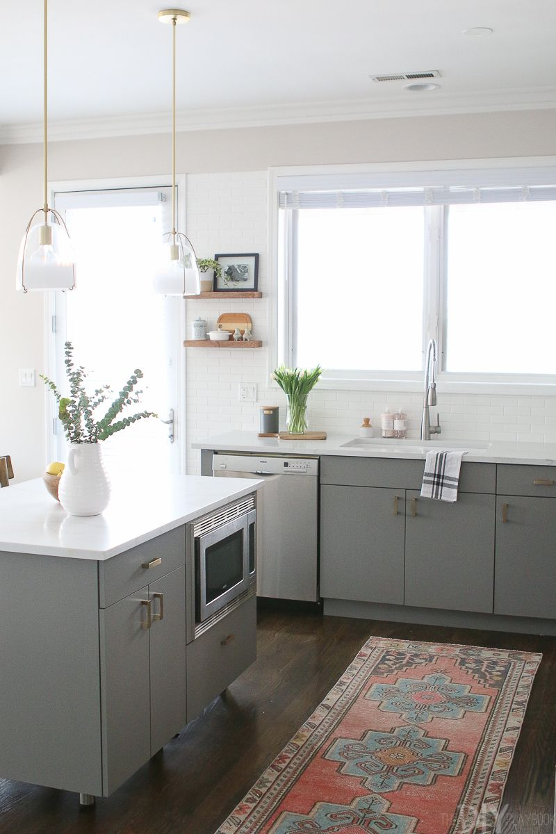 A White Ikea Kitchen Goes For A Touch Of Shine: 21 Ways To Style Gray Kitchen Cabinets