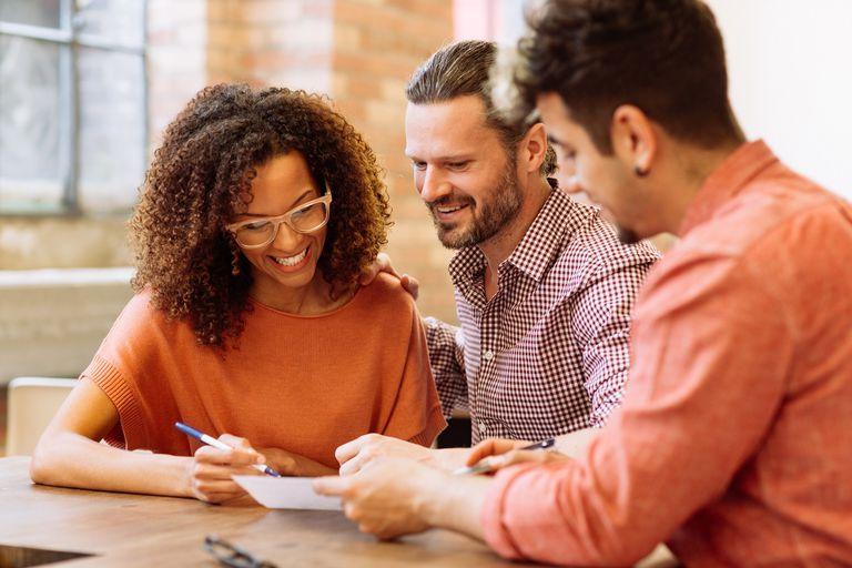 Economists reviewing a financial document