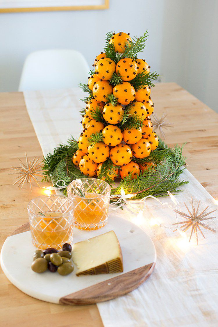 Christmas Topiary DIY Centerpiece made with oranges and greenery