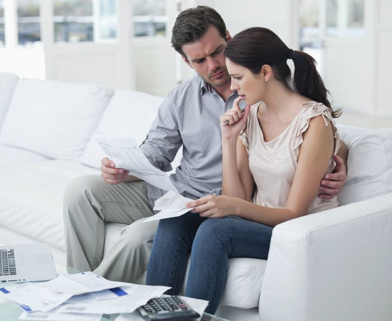 Worried couple reviewing paperwork