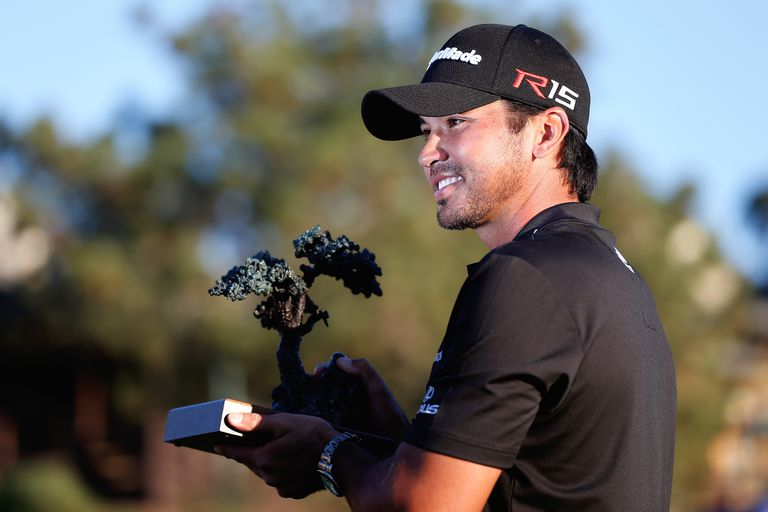 Jason Day poses with the championship trophy after his victory at the Farmers Insurance Open at Torrey Pines South on February 8, 2015 in La Jolla, California