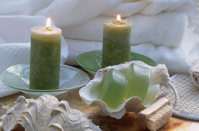 Candles Burning Beside Soap and Towels