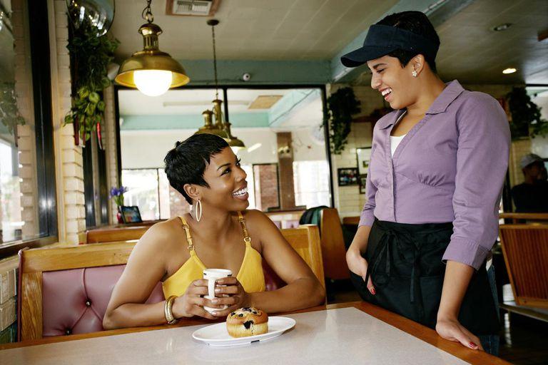 Waitress talking to customer in restaurant
