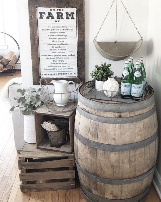 farmhouse setting with crates and a barrel