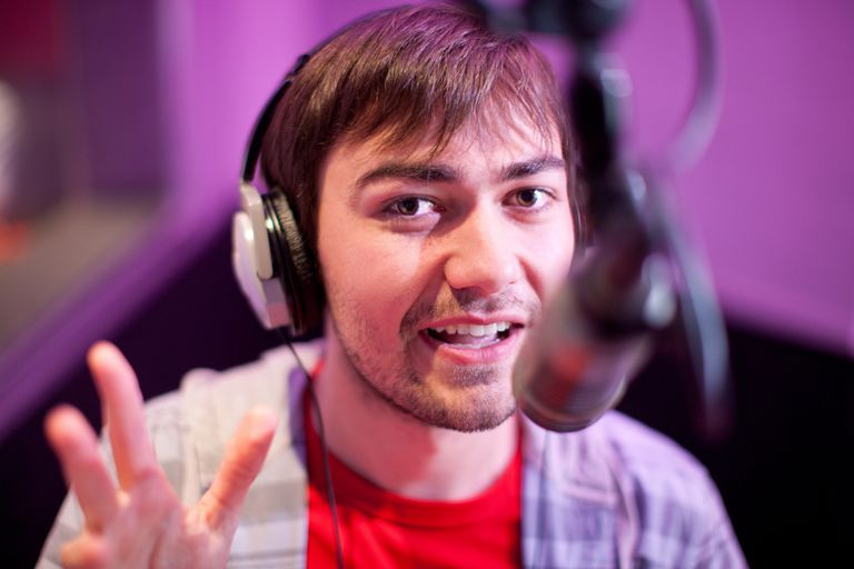 Young man broadcasting in recording studio, portrait