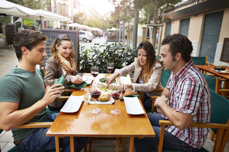 Two couples sharing tapas at restaurant