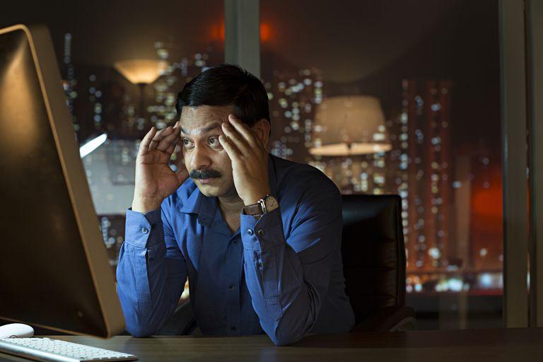 Stress businessman sitting in office