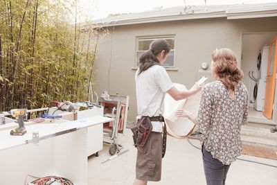 Woman talking with home contractor
