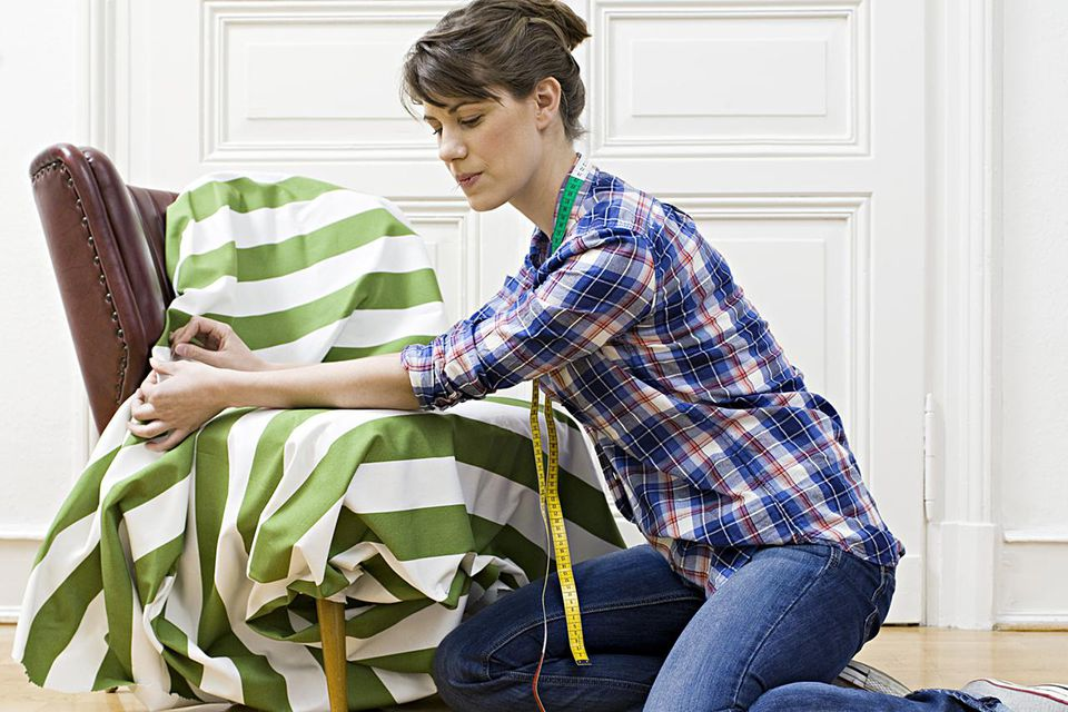 woman re-upholstering chair