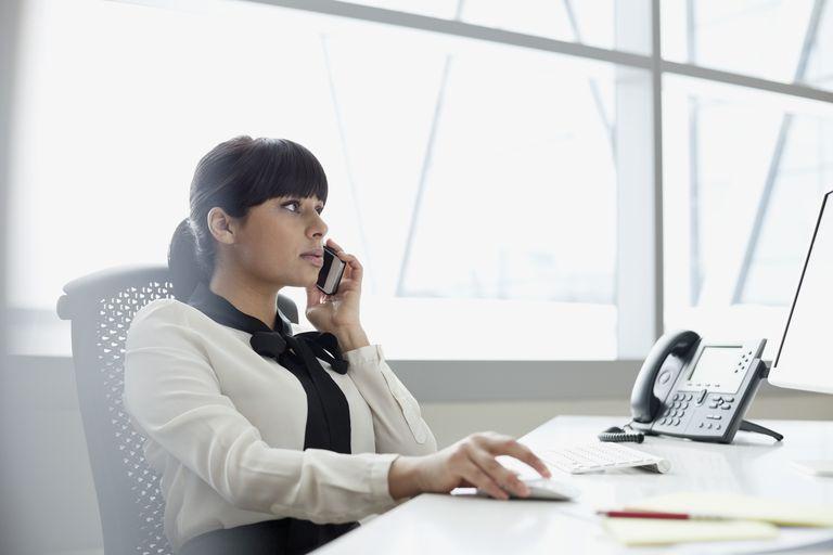 Businesswomen using mobile phone in office